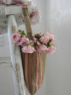 {Pretty chippy chair) with pink flowers and vintage feed-sack tote, love this photo}
