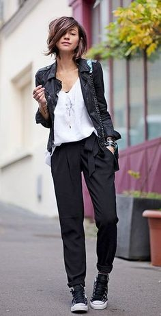 tied black pants and leather jacket with white tee and black & white sneakers