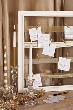 Share your intentions for the new year on our custom cards. Reclaim an empty picture frame to hold a variety of gold ribbon. Attach the ribbon on the back side, using a staple gun or hot glue. Clip cards to the ribbon with clothespins spray-painted gold.