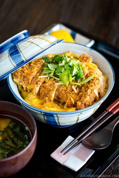 Juicy deep-fried pork cutlet and runny egg cooked in a savory and sweet dashi broth and placed over hot steamed rice, this Baked Katsudon recipe will be your new favorite weeknight meal! Japanese Rice Bowl, Japanese Dishes, Japanese Food, Easy Japanese Recipes, Asian Recipes, Ethnic Recipes, Katsudon, Pork Cutlets, Pork Cutlet Bowl