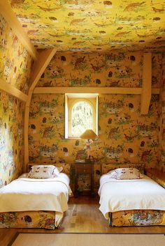 Children's guest room w/ Pierre Frey fabric in Agnès Monplaisir's country estate, photo Simon Upton for Harper's Bazaar