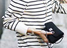 Chanel adds polish to almost any outfit, these nautical stripes are easily complimented by the bag.