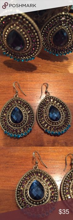 Bronze Bejeweled Earrings - STUNNING These are absolutely gorgeous and I hate to let them go. I purchased them from another posher in hopes my torn ear could handle them....but they are just a tad too heavy. They are so stunning! Center gem is a beautiful rich blue color surrounded by purple jewels in the center and with brighter blue jewels on the bottom edge. Really a pretty pair of earrings. Jewelry Earrings