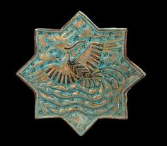 Tile | Origin:  Takht-i Sulayman,  Iran | Period: 14th century  Il-khanid period | Details:  In the Islamic world, ceramics makers emphasized brightly colored glazes and intricate designs to animate relatively simple shapes and architectural tiles. Drawing on a variety of decorative sources, they continually expanded and refined their repertoire of calligraphic, abstract, and figurative motifs. Some of the designs, such as the soaring phoenix on this fourteenth-century turquoise molded…