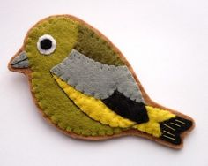 felt bird brooch- i think my grandmother would totally rock this- debating if i should make one, or just buy it.