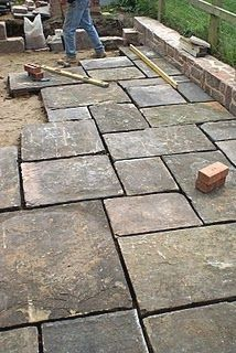 DIY a flagstone paver patio this weekend! We help you make this easy patio with our step by step instructions and materials list. Build a durable and long lasting paver patio that is great to place outdoor furniture! Flagstone Paving, Garden Paving, Paving Stones, Driveway Paving, Concrete Pavers, Paver Sand, Stone Driveway, Brick Walkway, Driveway Ideas