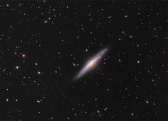 A spiral galaxy comparable to our own Milky Way, NGC 2683 is seen nearly edge-on in the cosmic vista.