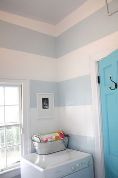 "The wall stripes in the Laundry Room are  Benjamin Moore's - ""Mountain Peak White"", ""Ocean Air""  and the Doors are ""Fairy Tale Blue"" (via tamarap1 in house ideas). Not sure if I have the patience to paint stripes. I do like them!"
