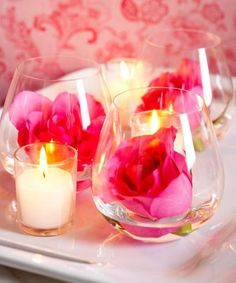 Buy stemless wine glasses that you like and add a rose bloom to each. Intermingle these with small candles. Now you won't be stuck with lots of vases at the end of your wedding -- you'll just have lots of fabulous wine glasses for when company arrives. Simple Wedding Decorations, Simple Weddings, Wedding Centerpieces, Easy Decorations, Simple Centerpieces, Wedding Simple, Valentines Day Weddings, Valentines Day Decorations, Table Rose