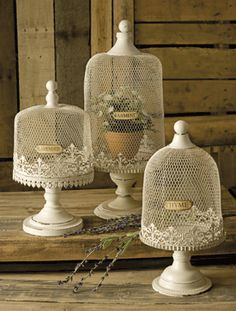 Norine Herb Terrariums    With a nod to the French country home, the Norine herb terrariums feature metal wire bell shaped enclosures perfect for growing potted lavender, jasmine and thyme.