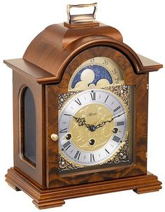 From www.theisenclock.com The Hermle Debden Keywound Moon Phase Mantel Clock is a shouldered arch mantle clock in Walnut finish. Features arched side glasses and a hinged back door. Made in Germany Functional etched moon phase dial indicates the different phases of the lunar cycle. Spun silver chapter ring with Roman numerals and and cast brass corner spandrels. 8-day 4/4 Westminster chime mechanical movement with night shutoff.
