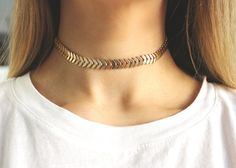 We're loving this shiny and minimalist choker.