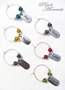Set of 6 Wine Charms with Glass Beads and Inspirational Word Charms.  Charms are 'Play', 'Hope', 'Faith', 'Love', 'Believe', and 'Destiny', and feature glass rondelles in bold colors.  Available while supplies last, only in the Pink Accents eBay boutique!