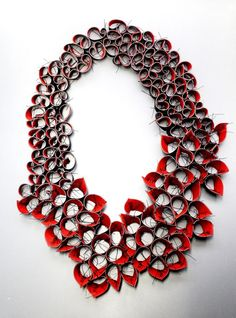 Niki Stylianou.Necklace.Hand cut,hand,painted and stiched rubbber,thead: