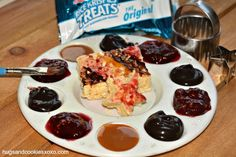 This treat is a ton of fun for the kiddies!!! You are essentially creating an edible palette of toppings for their rice krispy treats.
