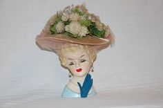 Vintage mid century blond lady head vase with hat, veil, pearl earrings, necklace, and glove. $120.00, via Etsy.