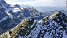 The world's first pedestrian suspension bridge to connect two mountain peaks opened on Glacier 3000 in Switzerland's Bernese Oberland in October. The 107-meter (351 feet) bridge connects View Point peak with Scex Rouge peak.