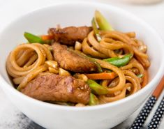 An oriental #pork #recipe with stir-fried with vegetables and #traditional #Japanese seasonings on a bed of soft #Udon #Noodles. Try this Sticky Pork and Vegetable Stir-fry with Udon Noodles recipe!