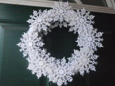 Snowflake wreath on a white base.