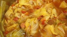 A package of onion soup mix flavors the tomato broth in which six different vegetables are combined with shredded cabbage in this fat free, low-calorie soup.