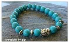 Check out this item in my Etsy shop https://www.etsy.com/uk/listing/253268486/blue-turquoise-buddha-bracelet