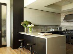 Travertine Kitchen - Beige and dark wood kitchen with travertine backsplash.