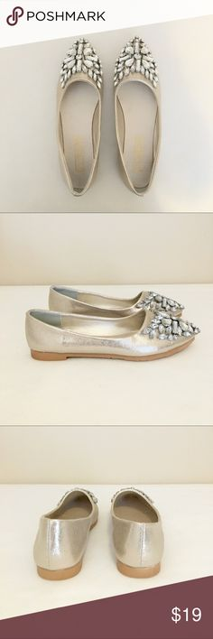 Gold Metallic Crystal Embellished Flats Pretty metallic gold pointy toe flats with large crystal embellishments on toes.  Size 7 but fit smaller, like a 6.5.  Brand new without box! Lily Vanity Shoes Flats & Loafers