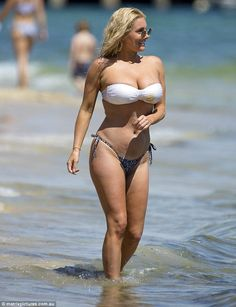 Busty babe! Zilda wore a white bandeau bikini that showed off a significant amount of clea...