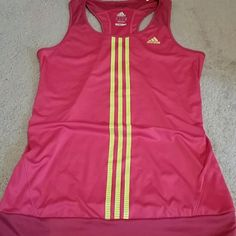 Adidas Climacool Tank Pink with yellow stripes. Has two spots as pictured behind neck. One is small hole, other is a stain. Size medium Adidas Tops Tank Tops
