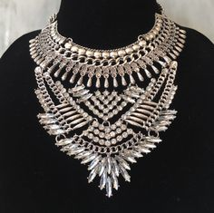 Crystal art deco style necklace with beautiful detailing. Statement neckwear styled fancy for any holiday party or dressed down with a pair of jeans