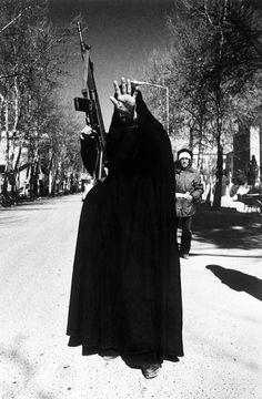 A woman  holds up her hand a day after the victory of the Islamic Revolution in Iran, Tehran, 12th February 1979