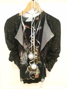 Elisa Cavaletti black chiffon top with floral print £159.95. InWear Black sequin Jacket was £149.95 now £89.95. Tutti&Co long blue and bronze glass beaded necklace £30.