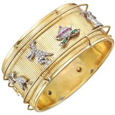 Preowned Art Deco Charm Cuff Bracelet ($22,000) ❤ liked on Polyvore featuring jewelry, bracelets, multiple, 14k bangle, cocktail jewelry, bangle cuff bracelet, cuff charm bracelet and 14 karat gold charms