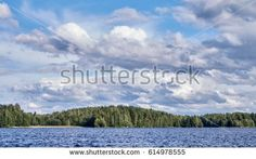 Stock Photo: Dramatic cumulus clouds in the bright summer day scene in Finland. -