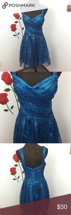 *9️⃣HOMECOMING Sparkly Blue Tulle Formal Dress Get this fabulous blue sparkly formal dress!  This is everything you can ask for in your future homecoming dress! Distressed features a crisscross detailing at the top as well as sparkly blue tulle.  There is a zipper closure at the back. This is new with tags. Get this now! Before time runs out and choosing a homecoming dress! Trixxi Dresses Prom