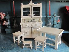 French Country style hutch, backless kitchen chairs, footstool and table