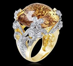 Citrine & Diamond Ring  A citrine ring with diamonds set in 18K yellow gold.