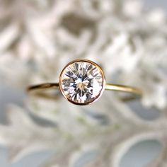 6.5mm Forever Brilliant Moissanite Engagement Ring In 14K Gold - Made To Order. $800.00, via Etsy.