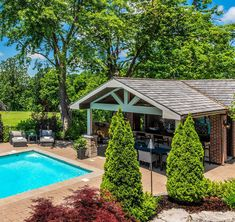 Small poolhouse design with covered bar & grill area. Brick paver patio. Red brick walls. Bathroom. Living space. In ground rectangle pool. Poolside seating.