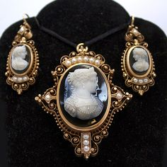 """Signed Victorian cameo set depicting Mary, Queen of Scots, set in 14k rose gold frames with intricate scroll work, beads and pearls. Hardstone onlyx cameos, the pendant cameo signed n the back, """"J. Gray,"""" """"HJ"""" and one additional signature which is illegible."""