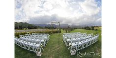 White resin chairs with  2 post natural bamboo arch
