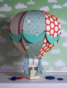 Hot Air Balloon from HIGH SKIES SVG KIT flying through the air!  We all love to stare at these up in the sky!  Why not make some to hang in your special space so you can always look up and have them to see!  Amy's is so fun with the papers she used!