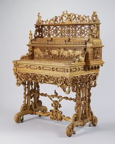 1851 Rococo secretary, displayed 1851 Crystal Palace, ML Wetli, Switzerland, purchased by QVictoria & PrAlbert,  mechanized,various lt woods, V&A Museum.