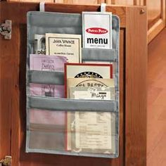Hang it out-of-sight on a cabinet door and organize to-go menus, mail, recipe clippings, address books and etc...