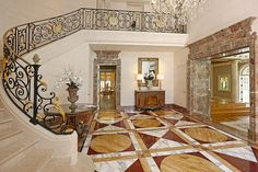 The foyer has handcrafted marble flooring and a handrail with French ironwork and gold flaking.