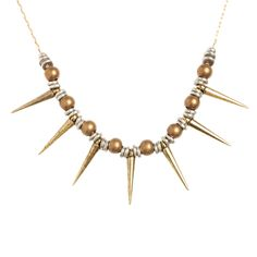 $58.00 Punk meets pretty with this unique spike necklace from Vanessa Mooney. Silver, brass and weathered copper come together to create a signature statement necklace you'll wear dressed up or dressed down.