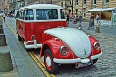 Bus towing custom-built VW Bug trunk trailer...how cool is this?