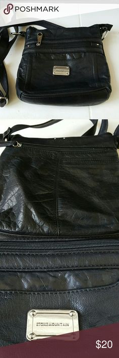 "Stonemountain Leather Crossbody bag Black leather with silver tone accents Frontband back zipper pockets with outside cell phone pocket Zip closure Gently used  9 1/2"" W x 9 1/2"" L Stone Mountain  Bags Crossbody Bags"