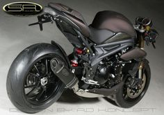 Image from http://triumphparts.files.wordpress.com/2012/09/triumph_speed_racer_6.jpg.