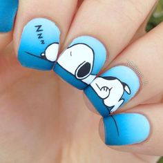 Snoopy nail art using OPI: 'gelato on my mind', 'no room for the blues', 'matte topcoat', Essie: 'hide & go chic', 'good to go'